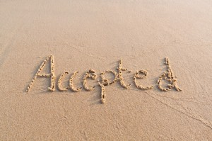 Picture of accepted written into a sandy beach